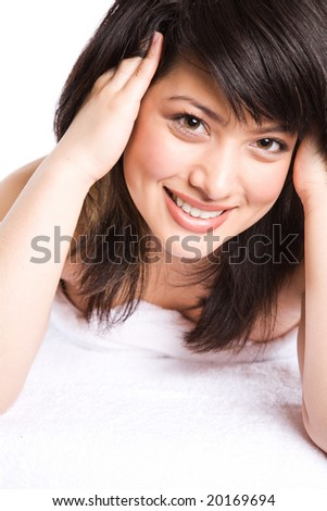 A beautiful asian girl getting ready for spa treatment - stock photo