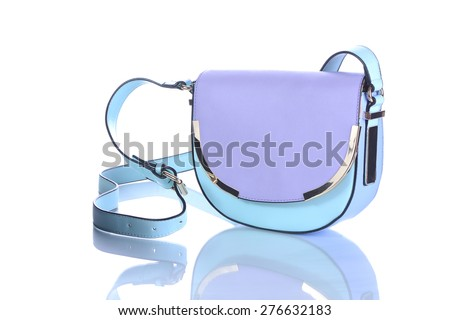 a beautiful bag isolated over a white background with reflection - stock photo