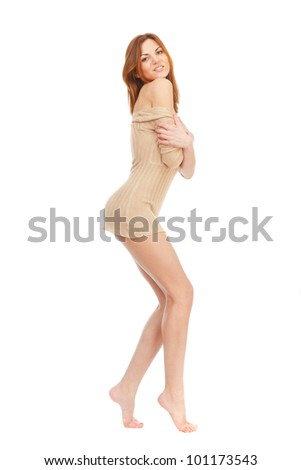 A beautiful barefoot girl with long beautiful legs on a white background. She smiles. - stock photo