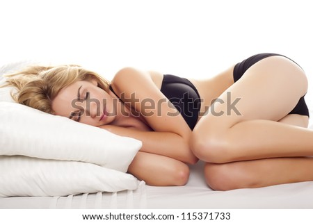 A beautiful blond woman having a relaxing sleep. Sleeping blond woman. - stock photo