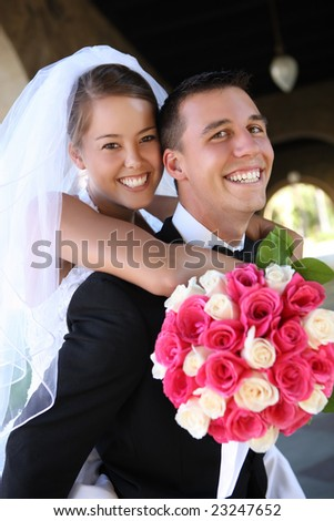 A beautiful bride and handsome groom at church during wedding - stock photo
