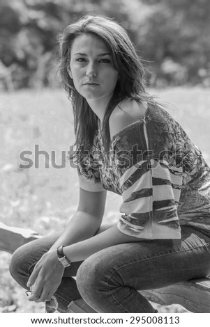 A beautiful brunette model posing in an outdoor environment - stock photo