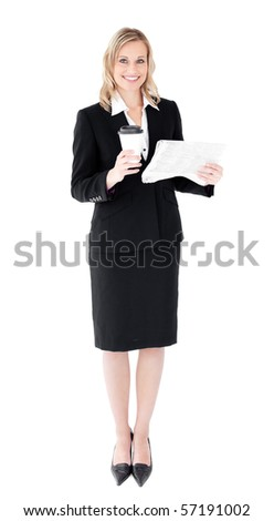 A beautiful businesswoman holding a cup of coffee reading a newspaper against white background - stock photo