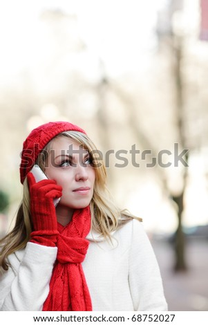 A beautiful caucasian woman talking on her phone - stock photo