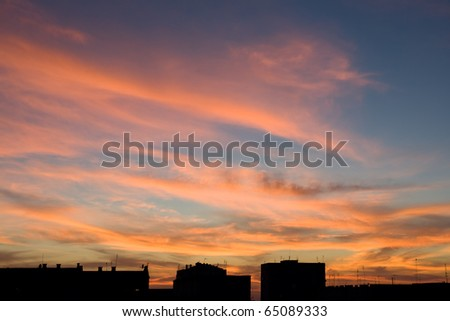 A beautiful cloudy sky at sunset pierced rays. - stock photo