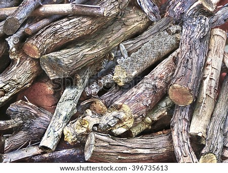A beautiful colorful closeup of logs in a woodpile - stock photo