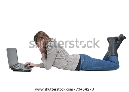 A beautiful computer savvy young woman using a laptop - stock photo