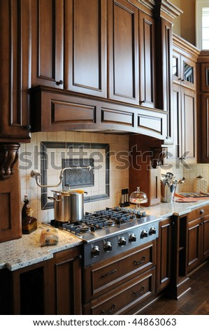 A beautiful custom gourmet kitchen - stock photo