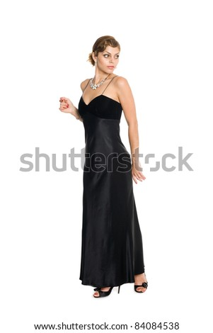 A beautiful elegant young woman in evening dress. - stock photo