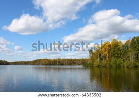 A Beautiful fall landscape over Beaverdam Reservoir in Gloucester Virginia with room for your text - stock photo