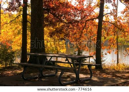 A beautiful fall picnic spot by the lake - stock photo