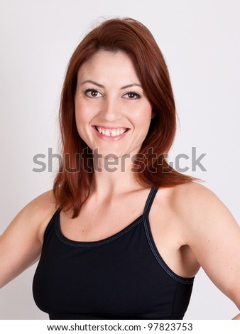 A beautiful fit red-haired woman - stock photo