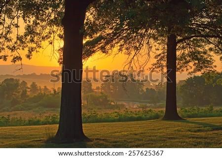 A beautiful foggy springtime sunrise in Lancaster County, Pennsylvania. - stock photo