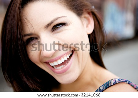A Beautiful Fresh Faced Woman smiling at the camera - stock photo