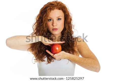 A beautiful girl holding an apple between her two hands. - stock photo