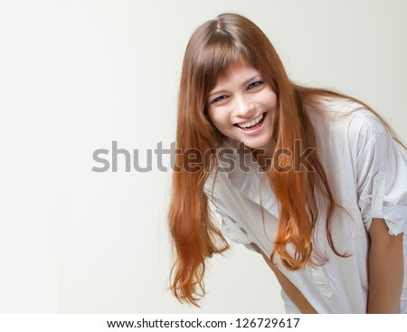 A beautiful girl in a studio. Isolated on a white background - stock photo