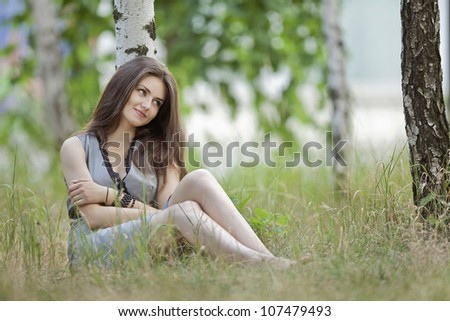 a beautiful girl in grey in an outdoor shooting - stock photo
