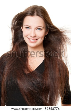 A beautiful girl with long hair, on a white background - stock photo