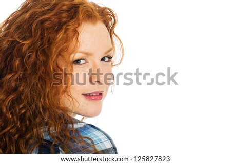 A beautiful girl with natural red hair and cute freckles - stock photo