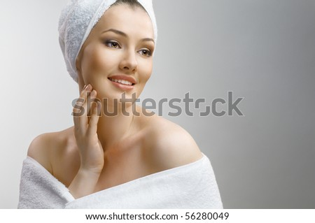 a beautiful girl wrapped in the bathtowel - stock photo