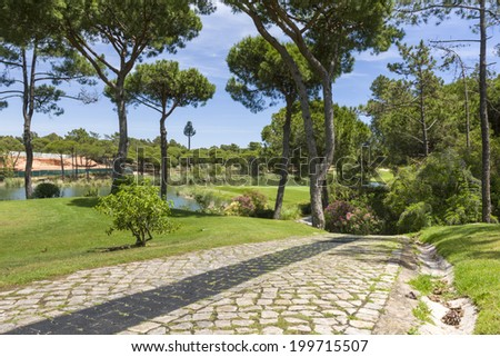 A beautiful golf course in Portugal during sunny day - stock photo