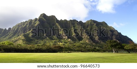 A beautiful green landscape of a mountain on Oahu in hawaii - stock photo