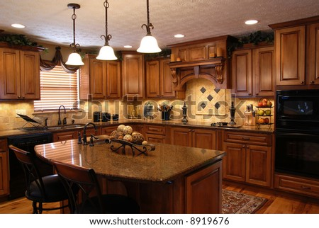 A beautiful interior of a custom kitchen - stock photo