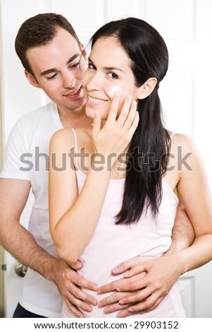 A beautiful interracial couple in the bathroom - stock photo