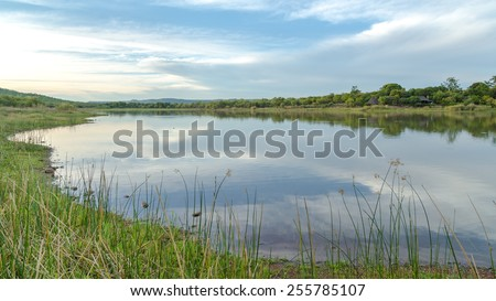 A beautiful lake in the middle of Mokolodi Nature Reserve in Botswana - stock photo