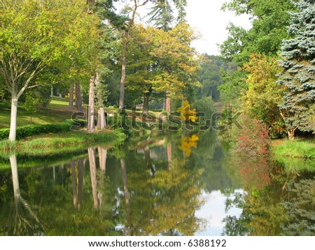 A beautiful lakeside setting in Sussex England soon after dawn - stock photo