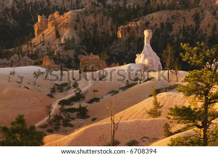 A beautiful landscape scene in Bryce Canyon at sunrise - stock photo