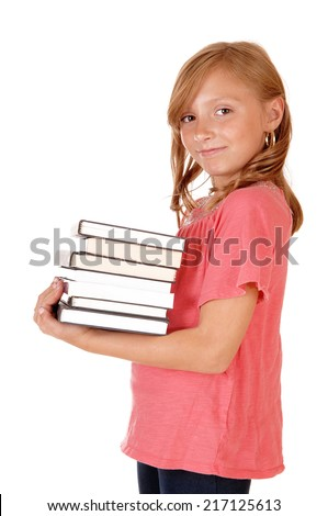 A beautiful little girl in a pink sweater and blond curly hair carrying her books, isolated for white background.  - stock photo