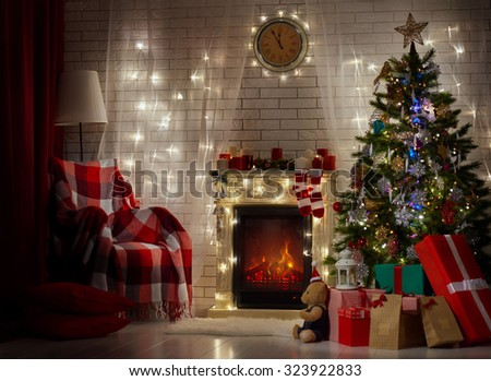A beautiful living room decorated for Christmas. - stock photo