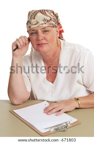A beautiful medical patient back on the job after chemotherapy. - stock photo