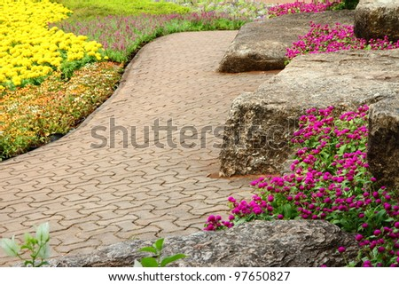 A beautiful nature path through in tropical garden - stock photo