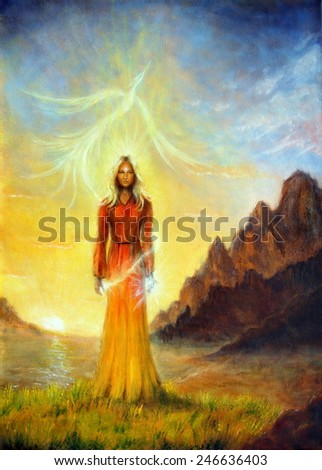 A beautiful painting oil on canvas of an enchanting mystical priestess in orange gown with a sword of light in a landscape bearing a shining sign up on the sky eye contact  - stock photo