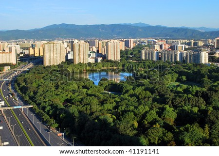 A beautiful park in the down town of Beijing city. - stock photo