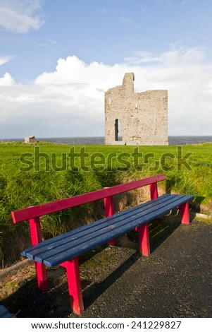 a beautiful path with benches to view Ballybunion beach and castle - stock photo