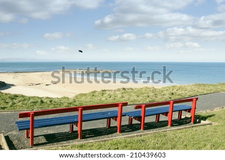a beautiful path with benches with views of Ballybunion beach and coast - stock photo