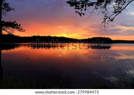 A beautiful photo of summer sunset over the one of Karelia's lakes. - stock photo
