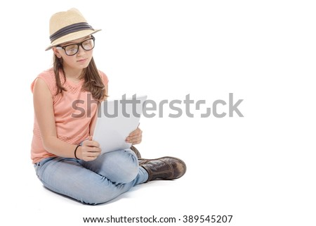 a beautiful pre-teen girl with a tablet computer. - stock photo
