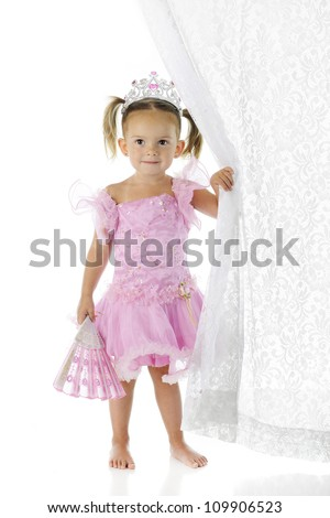 A beautiful preschool princess happily holding a folding fan in one hand while pulling back a lacy curtain in the other.  On a white background. - stock photo