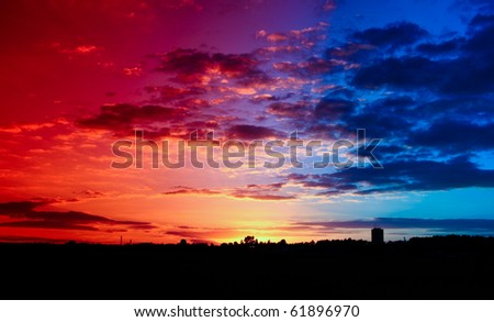 A beautiful red-blue sunset with visible rays - stock photo