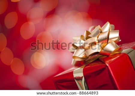 A beautiful red gift with Christmas ornaments - stock photo
