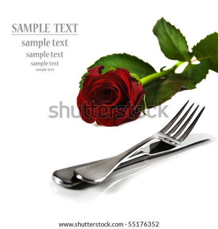 a Beautiful red  rose with a setting with knife and fork on a pure white background with space for text - stock photo