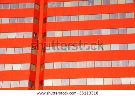 A beautiful red skyscraper under the blue sky in downtown edmonton, alberta, canada - stock photo