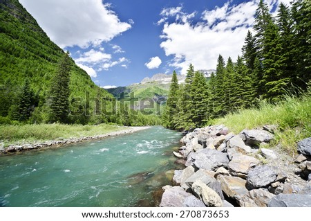 A beautiful river flowing at glacier national park - stock photo