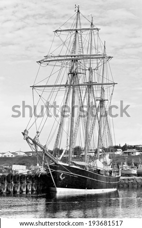 A beautiful schooner in the port of Reykjavik city, Iceland (black and white) - stock photo