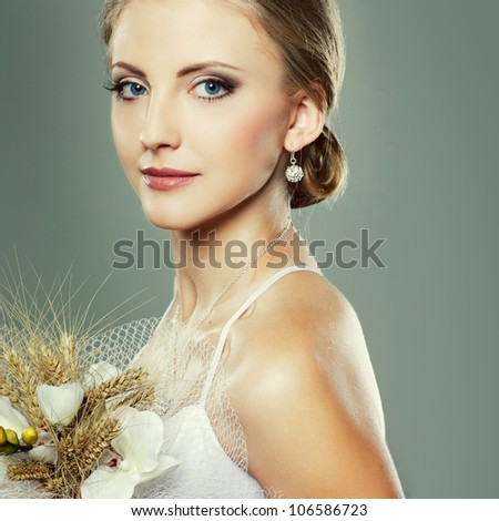 A beautiful sexual bride is in a wedding-dress, wedding decoration - stock photo