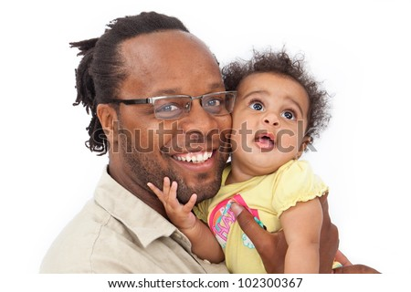 A beautiful six month old baby girl being held by her handsome father. Isolated against a white background - stock photo
